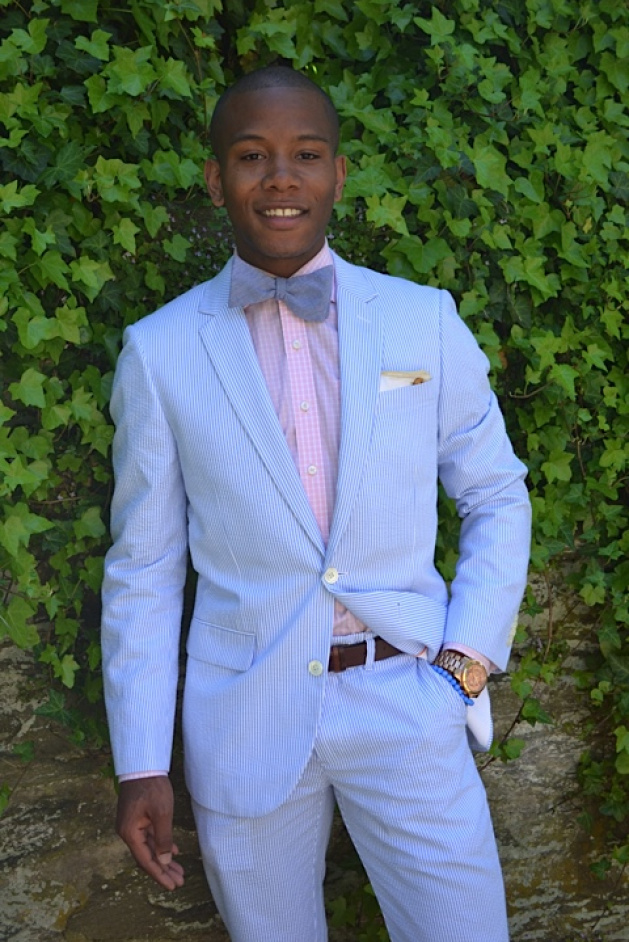 Blue suit pink bow tie